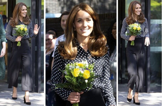 Kate wore navy polka dot blouse with high-waisted wide-leg black trousers.