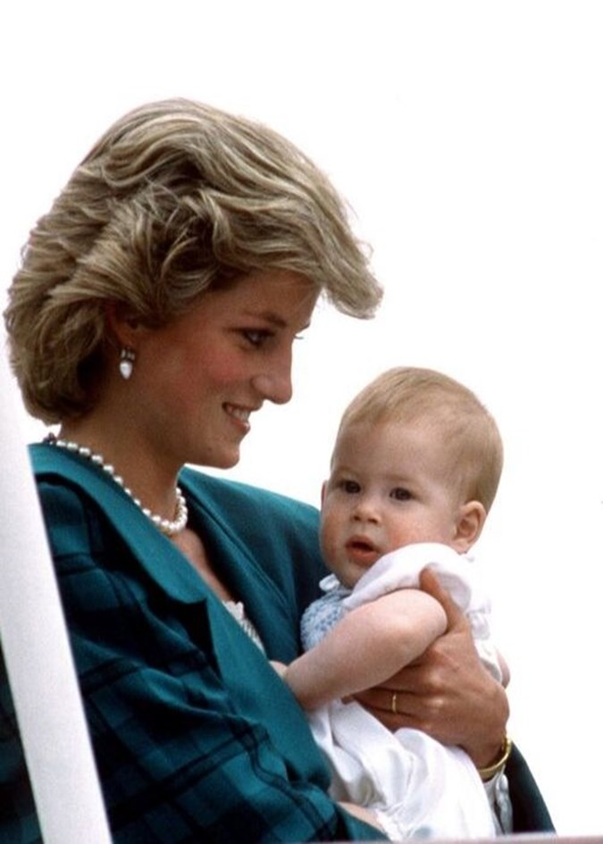 Prince Harry, at around eight months old, with Mum Princess Diana. Image: Getty