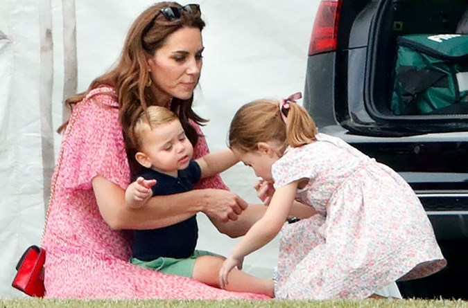 While engaging with one the tiny tots, the Duchess was seemingly reminded of her youngest child, Prince Louis, one, who hinted is going through a particularly clingy phase. Image: Getty