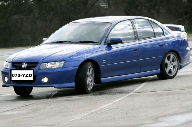 The man is travelling in a car described as being a blue, Holden commodore, Qld registration 072YZO