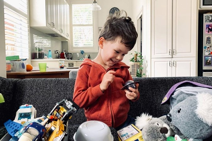 Dana's son Jasper is surrounded with toys including what looks like a purple Wiggle dress-up costume. Image: Dana Stephensen/Instagram