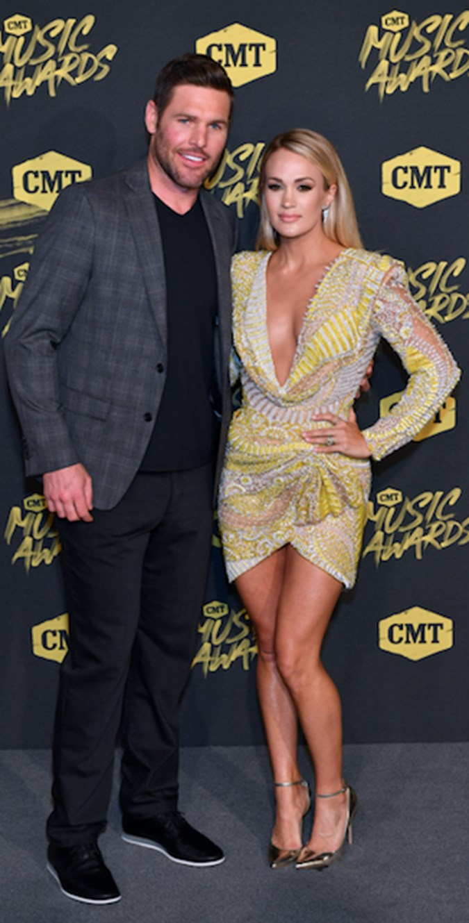 Carrie Underwood and Mike Fisher/Getty