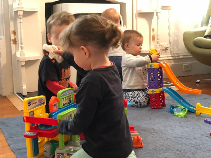 From Left: Ezra and Alba role play  with their trucks and cars, while Cara plays with the ramps and her little friend behind her, Louis, wanders around the pit!